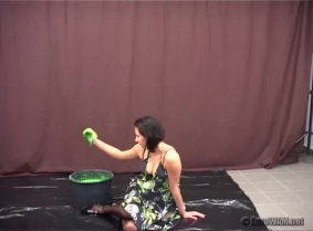 Vanessa choose for this clip a very sexy satin dress, black lingerie and black stockings. After she finished the bucket of green gunge she just play in the mess enjoying every second.