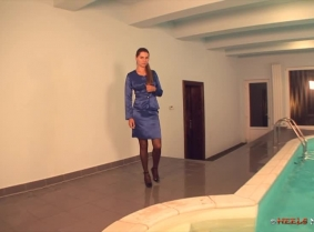 Blue satin suit, brown pantyhose and black patent very high heeled shoes. That is the outfit that Caroline is ready to soak today in the pool.