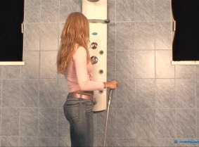 What should a girl do after she is back from shopping in a hot day? Well, you guessed... take a fully clothed shower to cool off. Caroline is wearing tight blue jeans and a seethru pink blouse and she wears no bra this time.