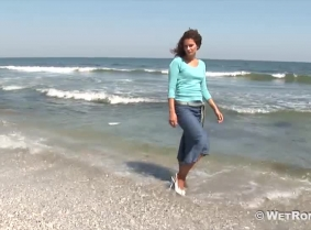 Denim skirt and casual blouse, tan pantyhose and high heeled shoes... That's Adina's outfit for today's swim.