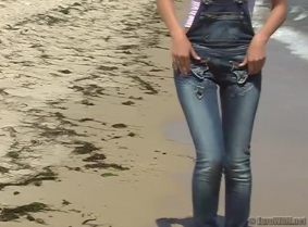 Just another normal day for Agnes. She went for a play in the sea, looking great with the shiny wet, tight jeans on her.