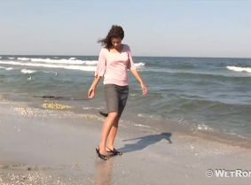 Despite the looks Adina is not going to the office – instead, she is off playing in the sea on a beautiful, hot summer day. As you can tell, she has a lot of fun during her joyful frolic in the sea, where her skirt and shirt get completely drenched
