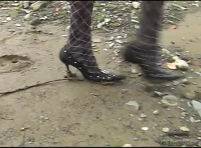 Black heels, black pantyhose and red dress. Evelyn get's really muddy.
