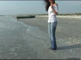 Enjoy the sea in the blue jeans and seethru blouse