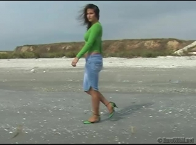 Green heels, blue jeans with pantyhose underneath and green blouse get soaked wet