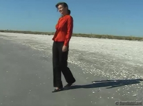 Dressed in office outfit Livia enjoy the sea.