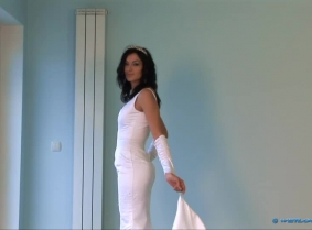 Some of our customers asked us to do some wedding gown clips. As usual, we listened to their suggestions, and what we have here is the first clip from a series of wet wedding gown clips. Ilka is wearing a superb white wedding dress over matching stockings