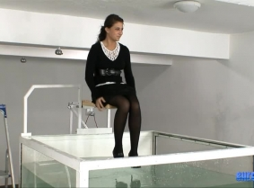 It's time for another business outfit to be dunked. Check out Raluca wearing a black skirt, pantyhose, heels and sweater. Fortunately or unfortunately, she didn't know the answers to many of our questions, and because of that, she often wound up dunked as