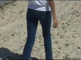 Livia is back into the sea... to soak another pair of jeans. She also wear a white blouse and high heels with nylon socks.