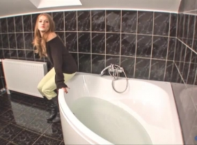 Here is another bathtub update for the sweater fans... Angela was kind enough to soak another outfit of hers for our viewing pleasure. In this update she wears light green pants, a black sweater without a bra underneath and matching leather boots.