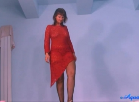 For those who missed her, Kris is back under the water, wearing a lace dress, stockings and high heels.