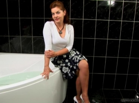 Nikolett is always ready for a bathtub wetlook session with her clothes on.