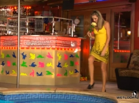 Julia is getting wet in the pool wearing a summer dress, heels and tan lycra pantyhose.