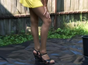 Sabine wears a yellow summer dress, sandals and stockings, which, eventually along with her topless body, all covered with green slime.