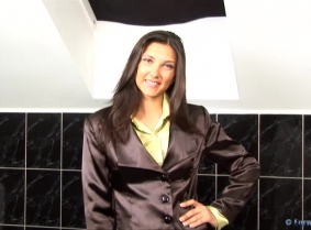 Michaela is ready for a new business meeting in the tub, she is wearing a black satin business suit and a green satin shirt, tan pantyhose and black patent heels.