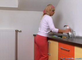 Judith is having a busy afternoon: she cleaned the entire house and she still has lots of dishes to clean. Now, normally you don't get excited when you wash the dishes, especially if you are not a wetlook fan like Judith is... In case you are, and you acc