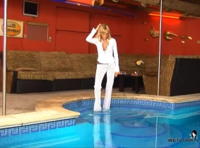 Alexa has a quick dip in the pool wearing a pair of striped pants, a sexy shirt and sandals.