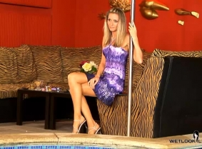 Julia is visiting the pool club again, and like most of her other trips there, she is all dressed up and ready for a nice soak. We hope you enjoy watching her soak her nylons, sandals and dress in the pool.