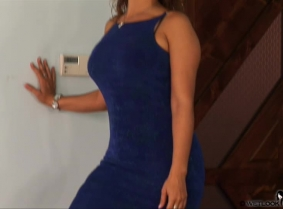 Kris is wearing a sexy blue dress, clack leather heels and tan pantyhose.