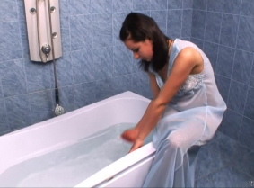 After the WAM fans enjoyed her on TrashTheGirl.com, it was time to introduce Oksana on the Sexy Wetlook site. So here is the first update with her, she is taking a fully clothed bath wearing a seethru night gown, fishnet stockings and heels.