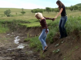 You asked for two girls in a clip, so we give it to you. Here are Judith and Adeline in a sexy mud play video. They both wear jeans, heels and blouses, and like every other clip on the site, this clip features a topless part.