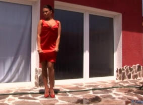 Red cocktail dress, red heels and tan sheer pantyhose... Mmmm, Maya loves to get wet.