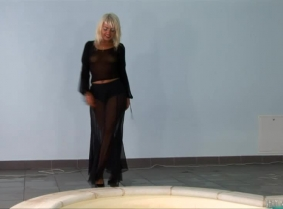 Judith loves the seethru outfits... so she had plenty of stuff to bring to the shootings... Here is another update with her, wearing a black lace skirt and top along with a pair of black heels.