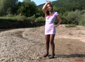 Theodora is back for another heels and legs messy session, wearing black heels and a simple summer dress