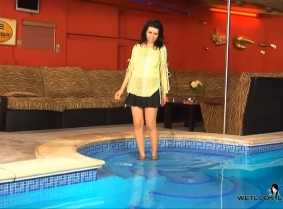 After all these updates with her, one would think that she soaked all of her clothes, but every time she comes back into the pool, she STILL has a new outfit to soak for us! We hope you enjoy this clip, and check back soon, because she may have another ou