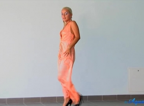 Judith is posing underwater, wearing an orange nightgown. As in most of her underwater updates, she will strip down to topless in the second part of the video.