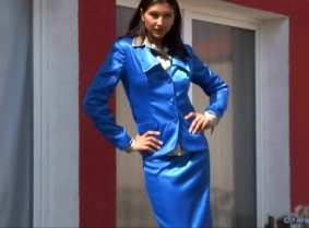Michaela's blue satin suit, white heels and sheer pantyhose become completely soaked under the shower.