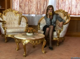 Katalin is just relaxing after a hard day at work, she is enjoying the silence from her library room and she is drinking a glass of orange juice. She is still in the phase when she need a reason to soak her clothes and  slipping some juice on her satin bl