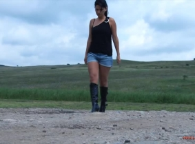 Eva's black high heeled boots, sheer pantyhose and short pants get really messy in the mudpit, and we hope that you enjoy every second of it. There is a 4 minute wash-off session at the end.