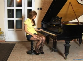 Anette started her piano lessons today and she was just rehearsing what she learned in her first lesson. It's true that during the entire lesson, the piano teacher (approximately 45 years old) could not take his eyes from her fishnet pantyhose covered leg