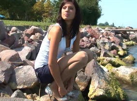 Edith is always ready for a dip in the lake, and today she wears a sexy mini skirt, pantyhose heels and a light blue top.