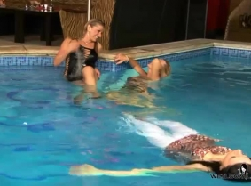 Alexa, Dana, and Laura are all together in the pool.