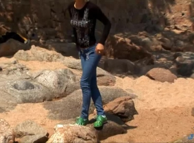 Dressed in a pair of tight jeans, a black blouse, a pair of green sneakers and white socks, Aida poses for the camera in the warm Mediterranean Sea. We hope you enjoy.