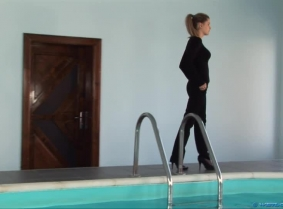 The story is simple: We have a young lady dressed in an office outfit, walking by the pool and an angry guy who pushes the girl into the water TWICE. It's a simple but effective script, and this was another custom clip we made for one of our customers on