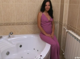 Hilda is looking hot in the bath wearing a purple, formal overall suit along with a pair of open toe heels and nylons. Hilda wears no bra under the clothes and her outfit looks great under the shower's spray.