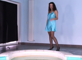 We asked Karida to bring for this update one of her own negligee's, one that is thin enough to became a little seethru when wet and look like a second skin on her sexy body. Enjoy watching her playing in the pool.