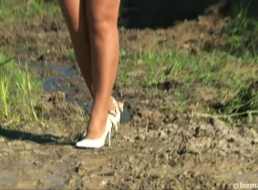 EvaV enjoys an afternoon mud play still wearing her full business attire, pantyhose and high heeled shoes.