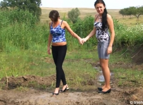 Adria and Timi are playing in the mud having a great time , messing each others casual clothes and later on during the clip each others topless bodies, while they are kissing in the mud. Have fun watching them