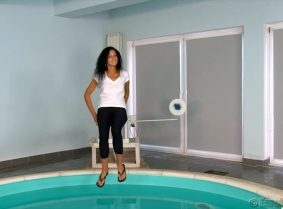 Alexandra is dunked for the first time. She is wearing a white t-shirt with no bra under, black leggings and a pair of flip-flops in a production originally made as a custom video production for a valued customer of custom-videos.com website.
