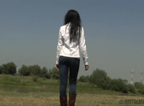 Adria is playing in the creek (under the delighted eyes of some fisher mans)  She is wearing a pair of casual boots, tight jeans a white jacket and a thin summer blouse under the jacket. No bra this time and the blouse goes fairly seethru...  As you can