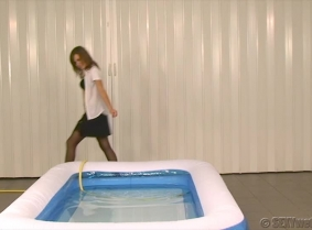 This clip is the second part of the T847C5A  update. After pouring the water from the bottles on her sexy business clothes, Enci went down where she knew there is a kiddy pool and using a hose with a shower head attached she cool herself off properly. Fo