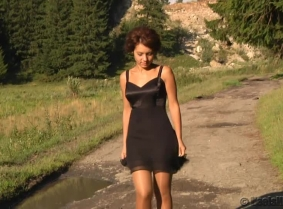 Rita is wearing tan pantyhose and dark blue pumps into  mud and puddles, covering her heels and nylons with thick mud and then washing the mess off in the water. The camera is focused on the heels, NO full coverage in this clip, only footage for the mess