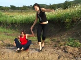 Adria and Timi are having fun together in the mud. The are starting the clip in casual clothes BUT they will end it topless and covered with mud.