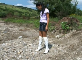Christine is messing her boots and her nylons into a mudpit. Wash off session included.