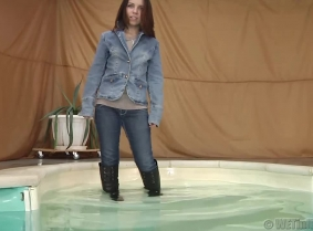 Nora is for the first time on the site, dressed as the jeans fans enjoys the most. She is wearing a full denim outfit and black boots over her jeans. Enjoy watching her, playing in  the pool.