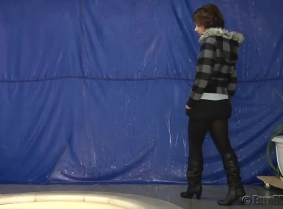 Rita is getting dunked in the pool while she is wearing one of her winter outfits. During the clip she removes the jacket and the sweater and even her boots.